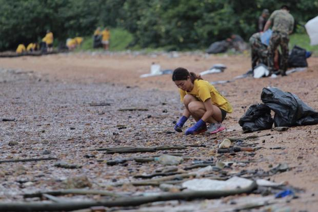 Volunteers collect rubbish that washed ashore at a beach on Koh Chang in Trat province during a clean-up organised by local authorities and tourism operators.JAKKRIT WAEWKRAIHONG