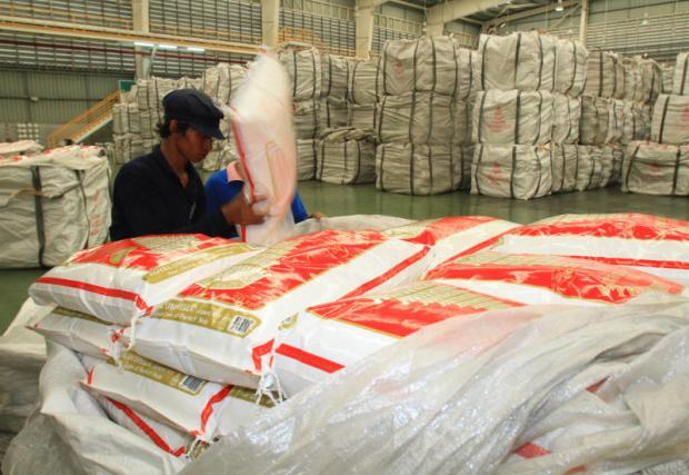 Workers arrange rice for export at a processing plant in Ayutthaya province. The Foreign Trade Department says Thai rice prices are competitive in the world market.