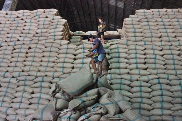Labourers unload sacks of rice at a warehouse in Pathum Thani.PONGPAT WONGYALA