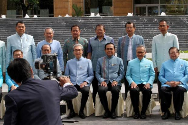 Prime Minister Prayut Chan-o-cha takes part in a group photo with ministers, Thai ambassadors in neighbouring countries as well as governors of 32 border provinces at the Foreign Ministry on Friday. (Photo by Apichart Jinakul)