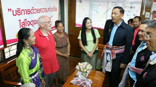 Social Development and Human Security Minister Anantaporn Kanjanarat talks to a foreigner and Thai women during the opening of a marital advice clinic in Khon Kaen.