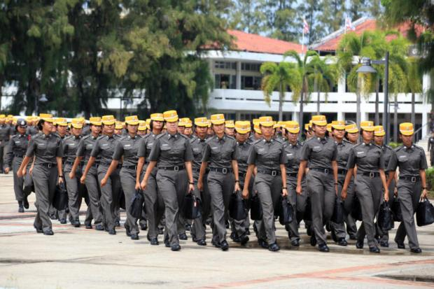 Female police cadets file into the grounds of the Royal Police Cadet Academy after their admission to the institute. The academy has made a controversial decision to scrap the admission of female cadets with immediate effect.Phrakrit Juntawong