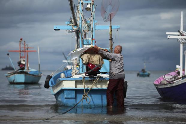 CATCH OF THE DAY: A fisherman in Samor Riang coastal community in Prachuap Khiri Khan's Hua Hin district moors his fishing boat. The man said his small business had not been affected by a labour shortage which mostly impacts large scale operations.