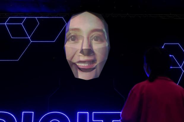 A giant face is one of the highlights at Digital Thailand Big Bang 2018. It illustrates a combination of facial recognition and AI for real-time identification. The fair runs until Sunday at Challenger Hall, Impact Muang Thong.  (Photo by Patipat Janthong)