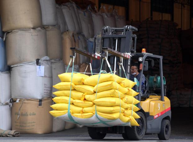 A forklift carries sacks of rice at a processing plant in Ayutthaya province. THITI WANNAMONTHA
