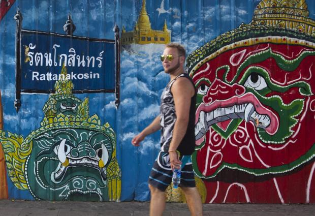 A foreign tourist walks along Ratchadamnoen Road. Bangkok was the No.1 global destination city for international overnight visitors for the fifth year in six. NUTTAPOL LOHAKIJ