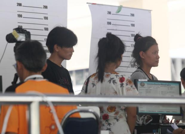 Foreign workers register at the Labour Ministry in June.APICHIT JINAKUL