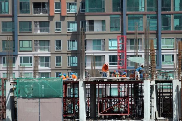 Construction workers at a condominium building. K-Research expects 190,000 residential units to remain unsold this year.