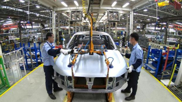 Men work at Ford Thailand Manufacturing's facility in Rayong province.