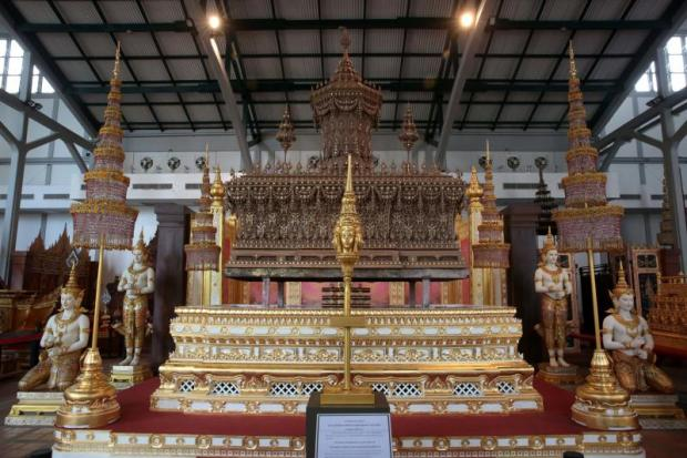 Items of lore: The ornate sandalwood outer casing of the royal urn and some decorative pieces used at the royal cremation last October were put on public display at the National Museum.