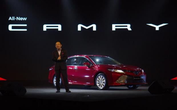 Mr Sugata with the new Camry. Production for NiMH batteries has been rescheduled to begin in the middle of next year.