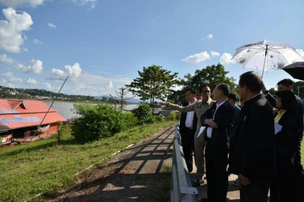 Mr Sontirat, third left, visits the private port along the Mekong River in Chiang Khong district to gauge the possibility of a cross-border SEZ under the Lancang-Mekong Cooperation scheme.