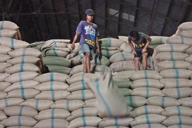 Workers sort rice sacks at a warehouse in Pathum Thani. Thailand is forecast to be the No.2 rice exporter in 2019, trailing India.