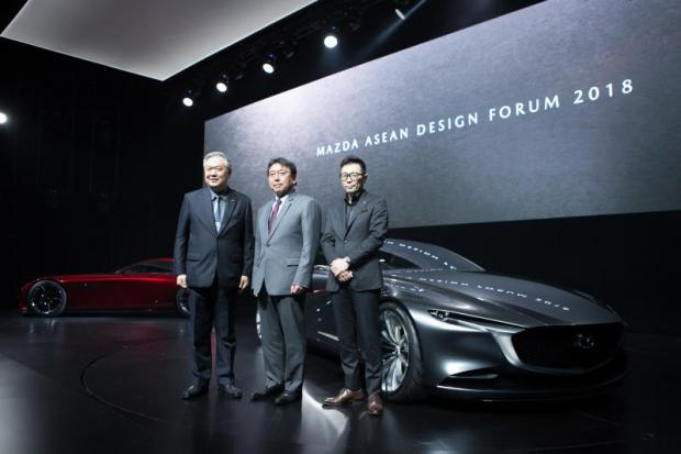 Mr Chanchai, left, and Mr Inoue, centre, in front of the Mazda RX-Vision Coupe at the company's Asean Design Forum 2018, held in Bangkok on Wednesday.