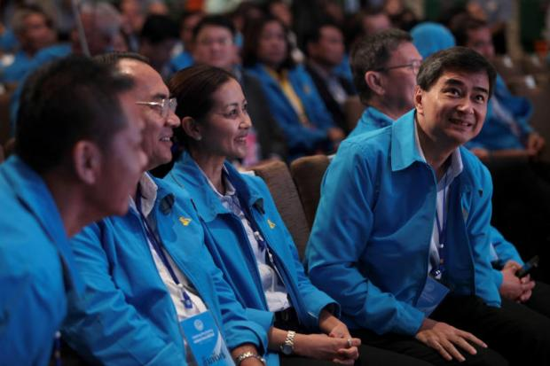 Abhisit Vejjajiva reacts as he is re-elected as Democrat Party leader for another term during a party meeting early this month.Bangkok Post photo