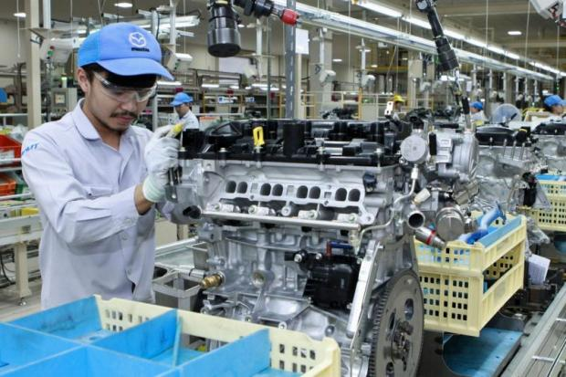 An assembly worker at Mazda Powertrain Manufacturing Thailand in Chon Buri. Mazda aims to seek more suppliers for new hybrid EVs.