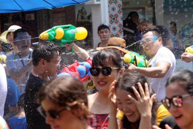 Chinese tourists enjoy water splashing on Khao San Road during Songkran, one of the highlights of the low-season calendar. (Photo by Apichart Jinakul)