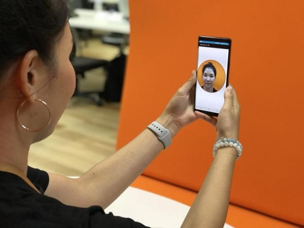 The TMB mobile app's facial recognition system lets customers open accounts using their smartphones.