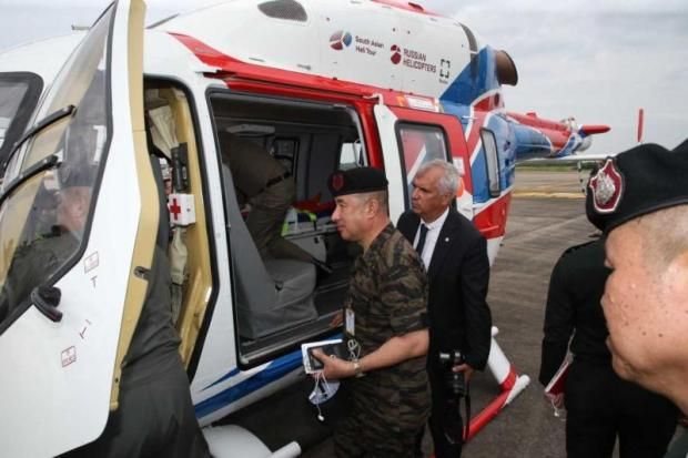 Thai military officials inspect the Ansat helicopter at a recent flight demonstration.