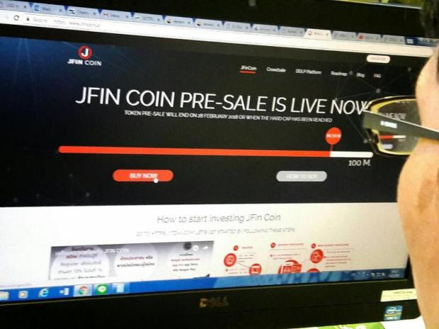 The JFin Coin pre-sale was conducted online earlier this year. Some ICOs have taken to raising funds overseas as regulatory development lags. ORANAN PAWEEWUN