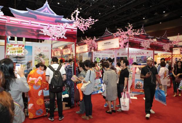 Visitors check Japan tour packages at a travel fair.TAWATCHAI KEMGUMNERD