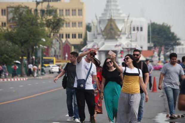 Foreign tourists walk near the Grand Palace and Wat Pho. PAWAT LAOPAISARNTAKSIN
