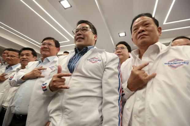 Palang Pracharath Party leader and Industry Minister Uttama Savanayana, second right, gestures along with party executives, at the unveiling of the party's election manifesto yesterday. Chanat Katanyu