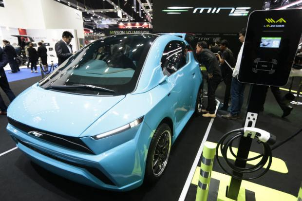 A Mine Mobility car prototype at the Bangkok International Motor Show in 2018. EA aims to market this EV in 2019.Patipat Janthong