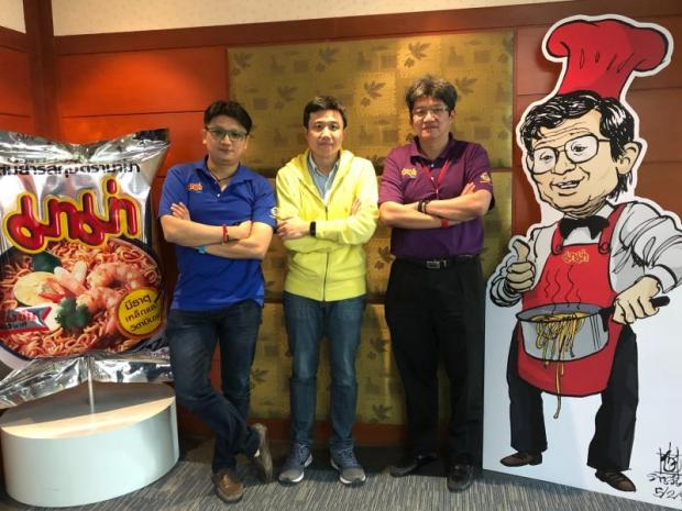 From left Mr Pun, Mr Petch and Mr Poj are beefing up instant noodle production abroad. PITSINEE JITPLEECHEEP