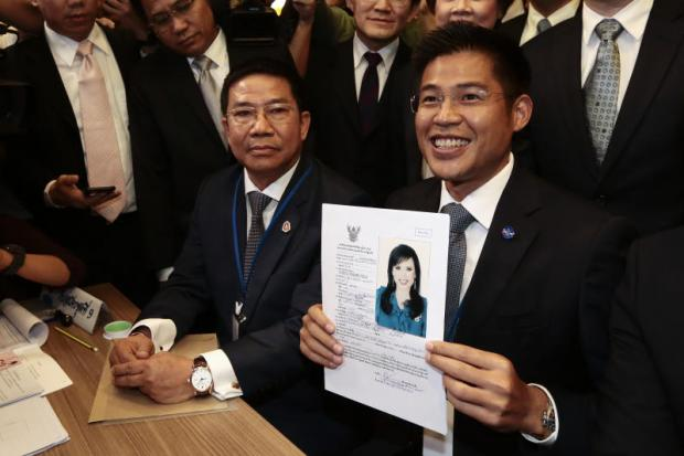 King blocks Thai princess' prime minister bid; pressure mounts to dissolve party