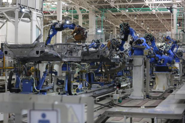 Robots assemble cars at Honda's manufacturing plant in Prachin Buri. (Photo by Pattanapong Hirunard)