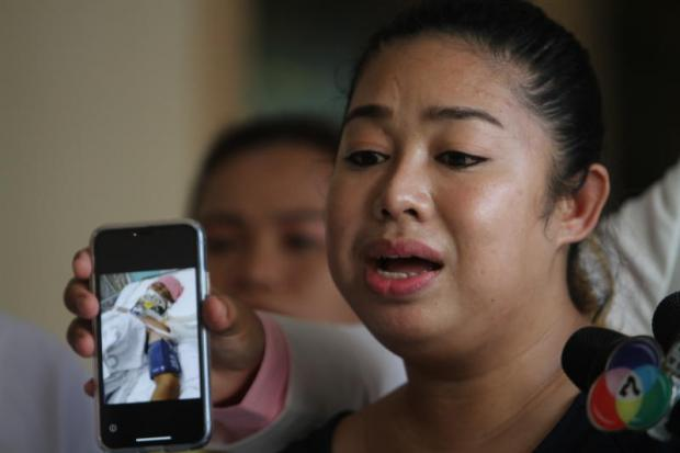 Atchara Jaidee, 28, speaks to reporters about a car accident, allegedly involving a US embassy car, which left her husband on life support.Apichart Jinakul