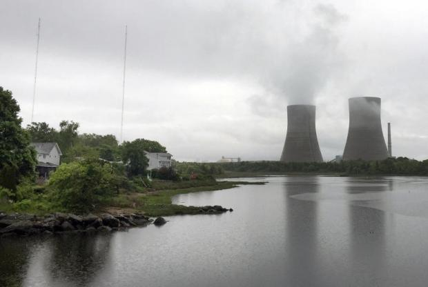 Brayton Point Power Station, New England's largest and one of its last coal-fired power plants, along Mount Hope Bay in Somerset, Massachusetts. The decommissioned plant, which began generating electricity in the 1960s, is set to be demolished on April 27.(AP photo)