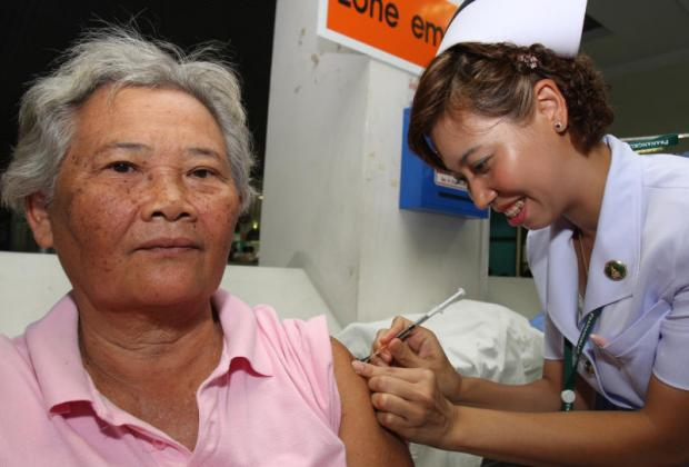 An elderly woman receives a vaccination at a hospital in Nonthaburi. Statistics show women seek medical care from public hospitals more than men. TAWATCHAI KEMGUMNERD