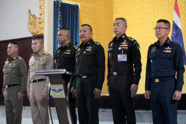 From left National police chief Chakthip Chaijinda, navy chief Adm Luechai Ruddit, defence permanent secretary Gen Nat Intaracharoen, chief of the Defence Forces Gen Pornpipat Benyasri, army chief Gen Apirat Khongsompong, and air force chief ACM Chaiyapruk Ditsayasarin jointly announce their post-election stance at the 11th Infantry Regiment, declaring they are ready to work with the new coalition government — regardless of which political parties come to power and who is named premier.Chanat Katanyu