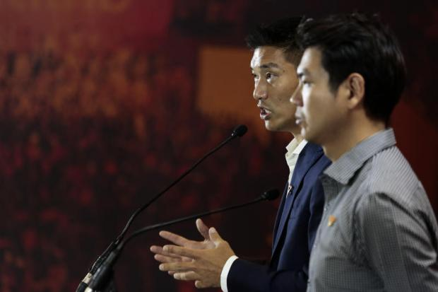 Future Forward Party leader Thanathorn Juangroong-ruangkit and party secretary-general Piyabutr Saengkanokkul speak at a press conference in Bangkok on March 25 following the general election in which their party finished third.PATIPAT JANTHONG