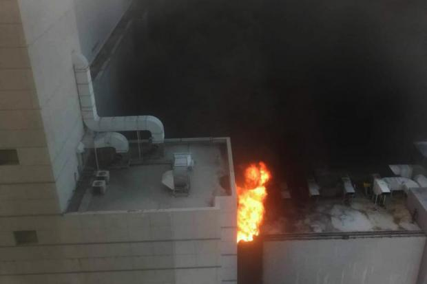 A fire breaks out at CentralWorld shopping complex in Ratchaprasong area yesterday.Police photo