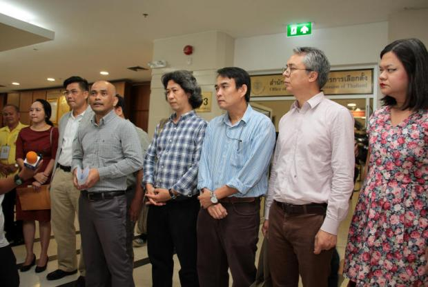 Members of the Thai Academic Network for Civil Rights speak to reporters after submitting a letter to the Election Commission asking it to withdraw defamation lawsuits against people who criticised the commission for its handling of the March 24 poll, among other issues. Tawatchai Kemgumnerd
