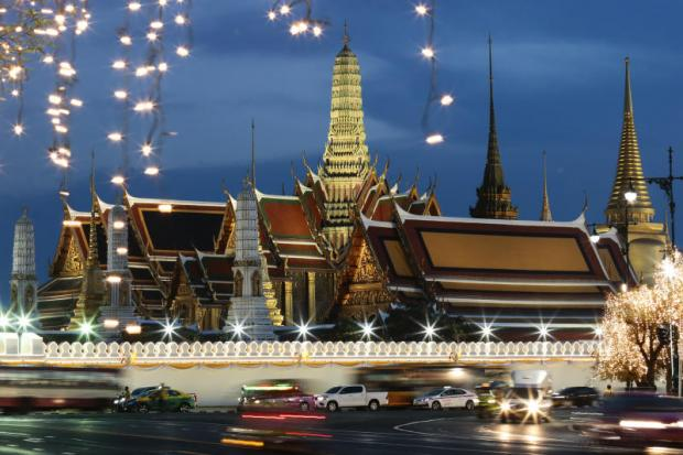 Decorative lights illuminate the walls of the Grand Palace and surrounding roads ahead of His Majesty the King's coronation ceremonies from Saturday to Monday. The King will perform the 'liap phranakhon' ritual on Sunday, during which he will make short trips to several parts of the capital.(Photo by Patipat Janthong)