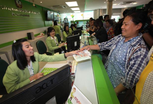 Farmers use services at a BAAC branch in Lop Buri province. The BAAC lent 678 billion baht in the 2018-19 financial year.