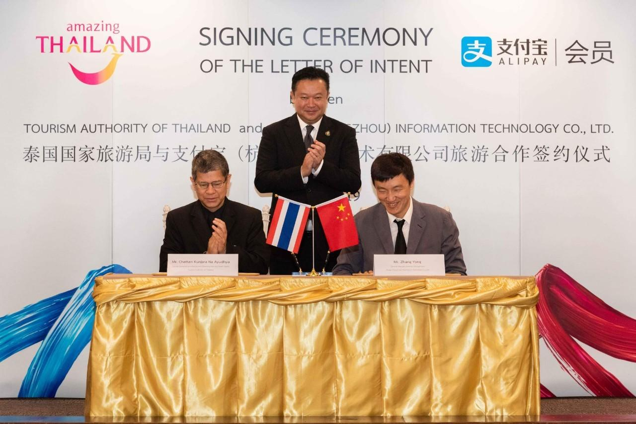 Mr Yuthasak celebrates the letter of intent between the TAT and Alipay that was signed on Monday.