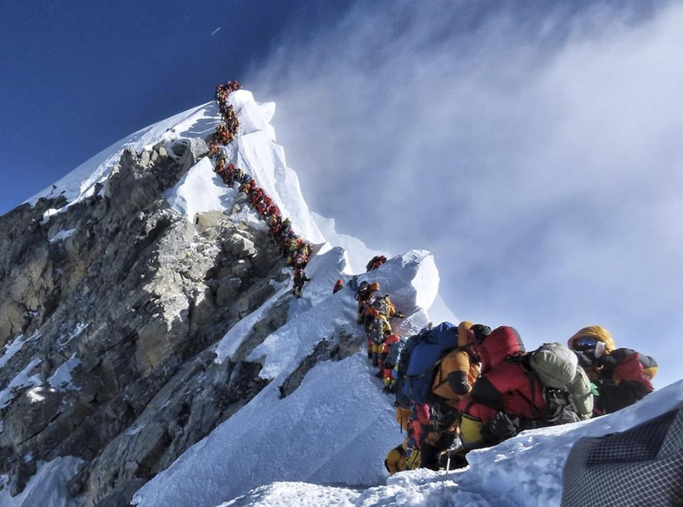 snail trail: In this photo taken on May 22, long queue of mountain climbers line a path on Mount Everest.