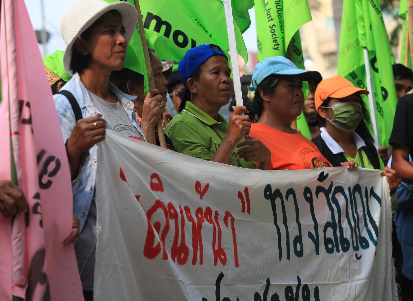 P-Move, a grassroots group which campaigns for land rights for the poor, submits a petition at Government House asking for the state to speed up land allocation to forest communities and give them rights and protection. Yet several forest dwellers face harsh punishment.Somchai Poomlard