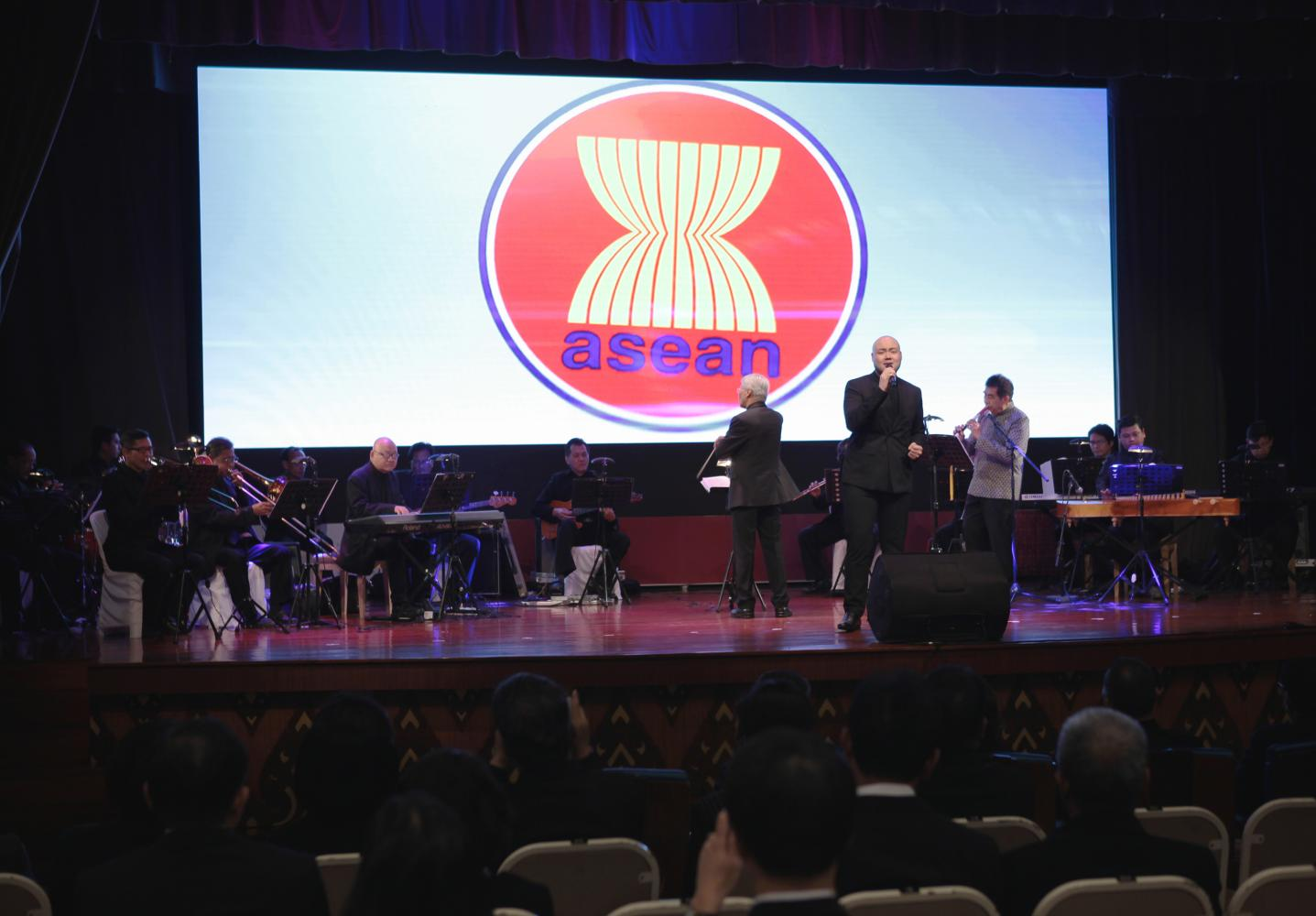 Musicians perform an Asean theme song at the National Theatre in Bangkok to promote Thailand's role as Asean chair. Tawatchai Kemgumnerd