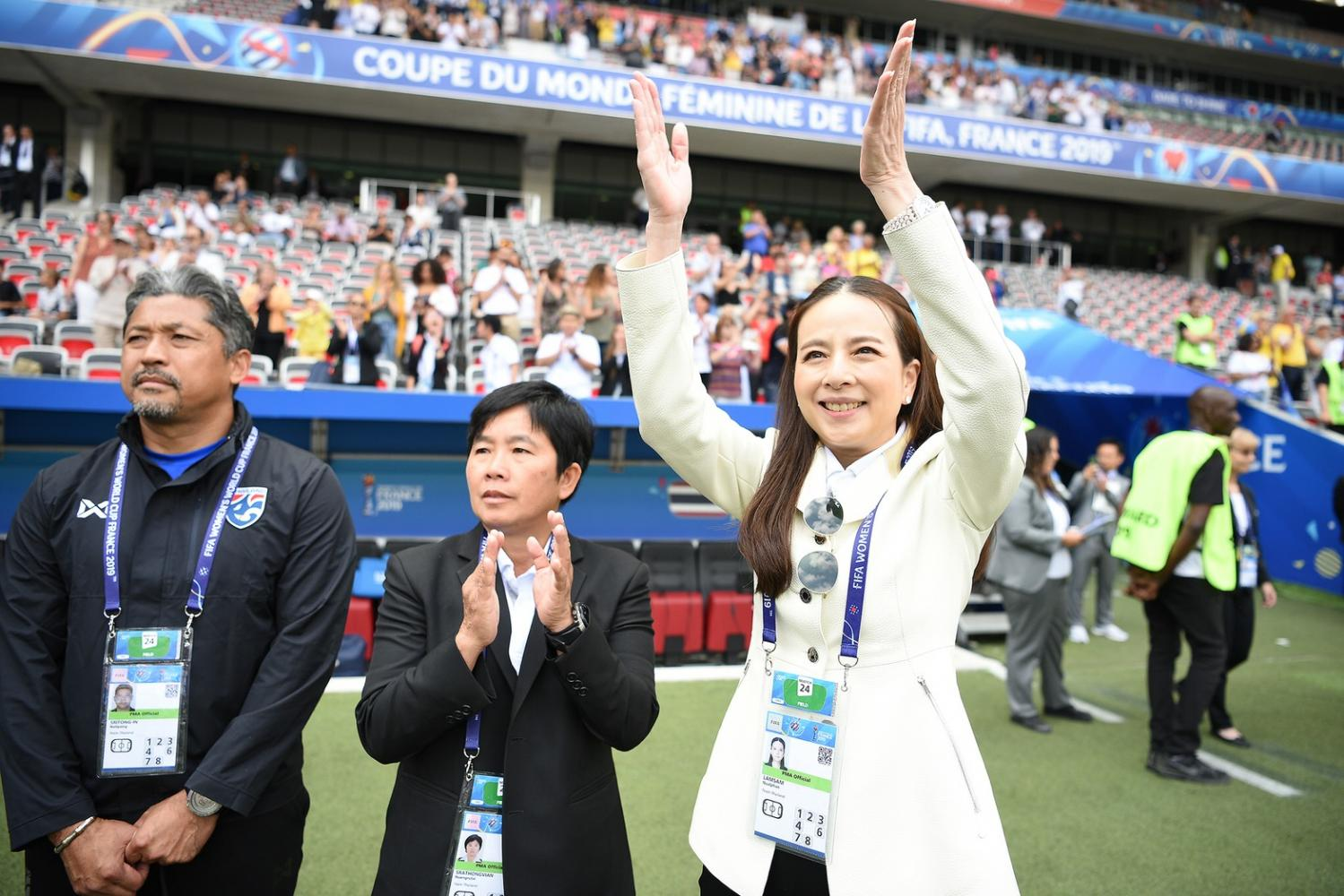 Manager Nualphan Lamsam, right, and coach Nuengruethai Sathongwien, centre, react after Thailand's match against Sweden at the Women's World Cup in France.