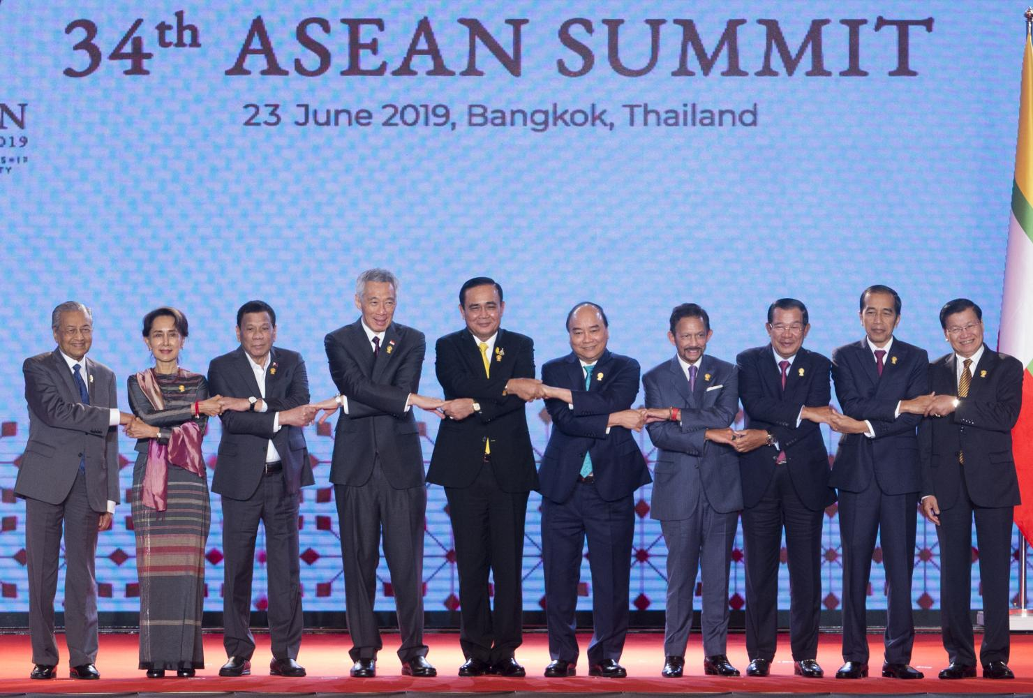 Southeast Asian leaders shake hands on stage at the start of the last day of the 34th Asean Summit at the Athenee Hotel in Bangkok on Sunday. (Photo by Pattarapong Chatpattarasill)