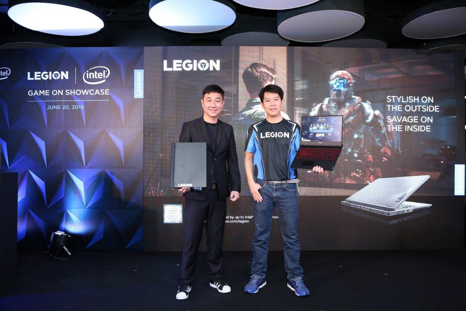 Thaneth Angkasirisan (left), general manager of Lenovo Indochina, with Mr Takon. Lenovo will boost spending on marketing in the second half to capitalise on the gaming boom.