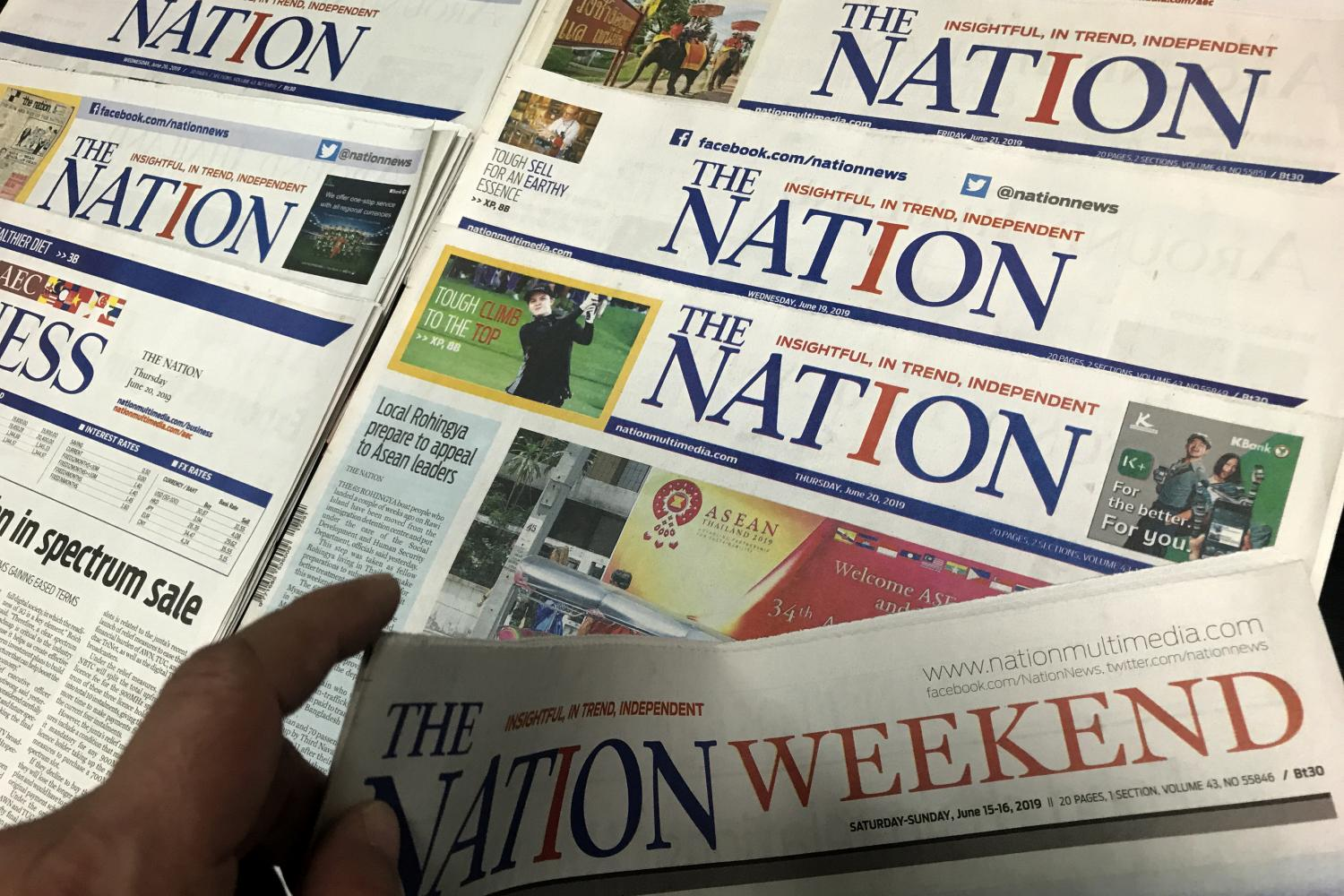 Copies of 'The Nation'. The newspaper will print its last broadsheet edition today.Pattanapong Hirunard
