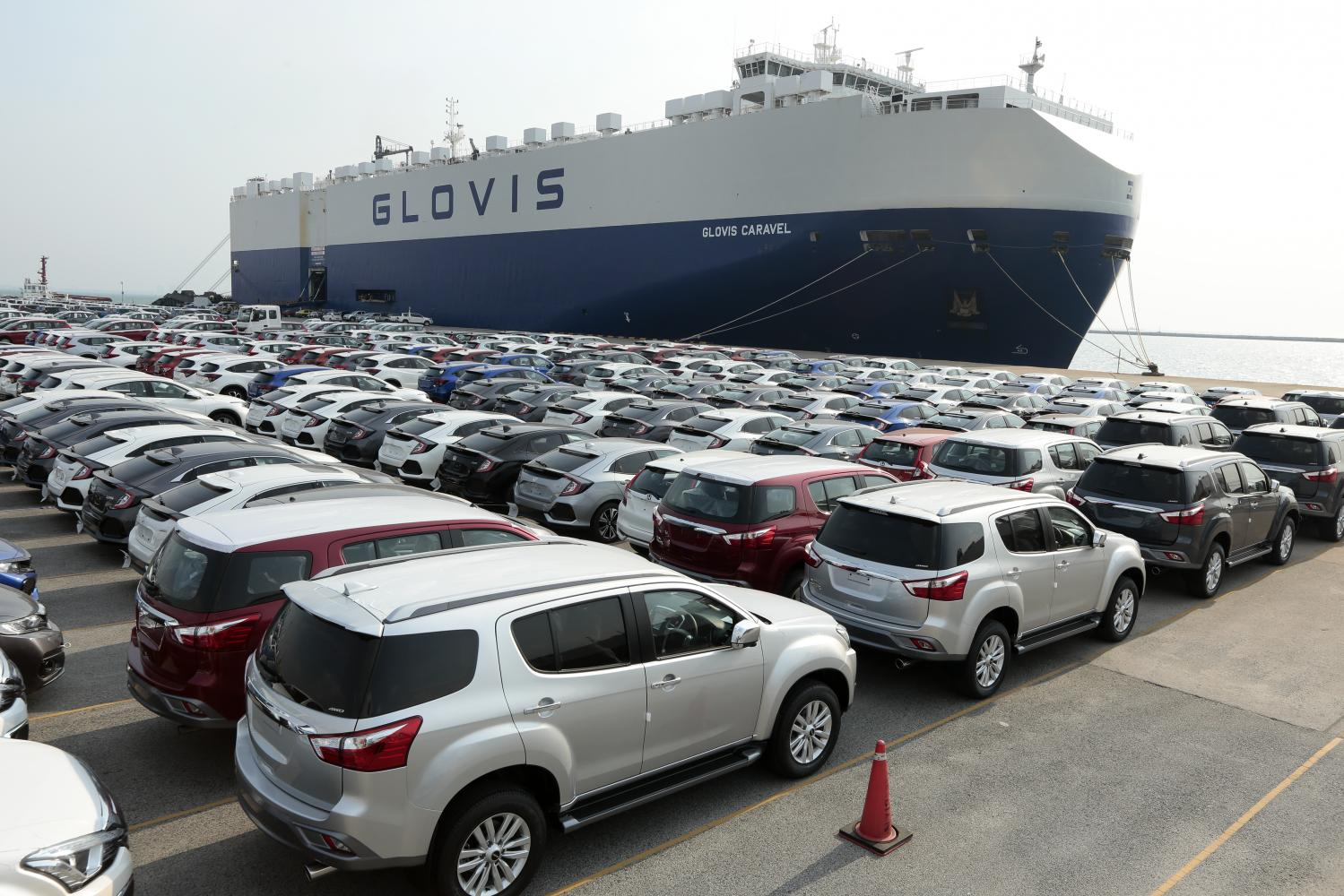 Thai-made vehicles await shipment at Laem Chabang port in Chon Buri. The government says automotive suppliers should prepare for many car makers to relocate manufacturing facilities to Vietnam.