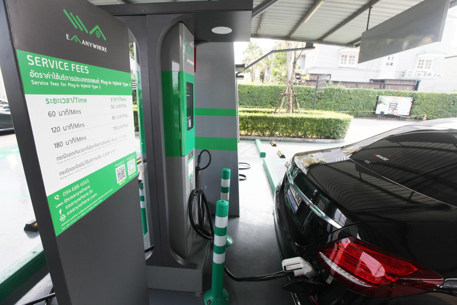 A plug-in hybrid car is charged at the EA Anywhere station at the Crystal Design Centre. EA is committed to having 1,000 charging stations by 2019. Thiti Wannamontha